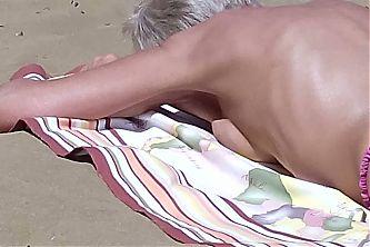 sunbathing granny...nice ass