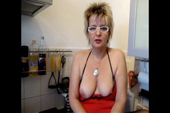 german granny plays with pussy and tits in kitchen