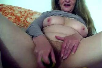 horny granny playing with cucumber on cam -  by GranDBastard